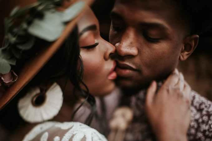 close up photo of man kissing woman
